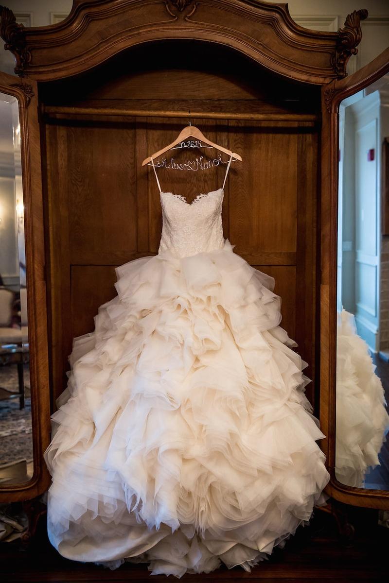 Strapless Lazaro wedding dress with sweetheart neckline, Alencon lace bodice, ruffled skirt