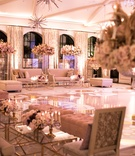 Wedding after party seating areas around dance floor starburst chandelier high centerpiece gold