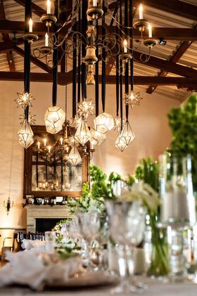wedding reception bel air bay club fireplace pendant lighting star and diamond shapes geometric