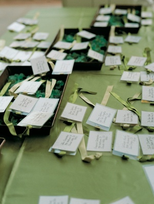 Luggage tag place cards in trays of beach glass