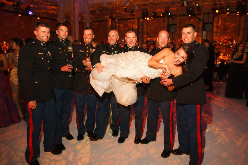 Bride lifted up at reception by USMC men