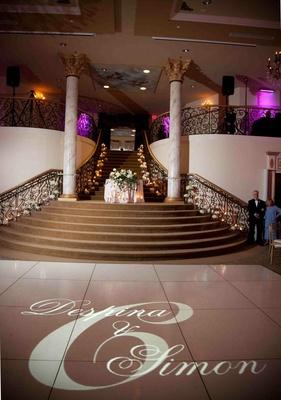 Gobo lighting on dance floor at ballroom wedding