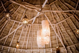 Inside view of thatched roof in Mexico venue wedding rehearsal dinner welcome party