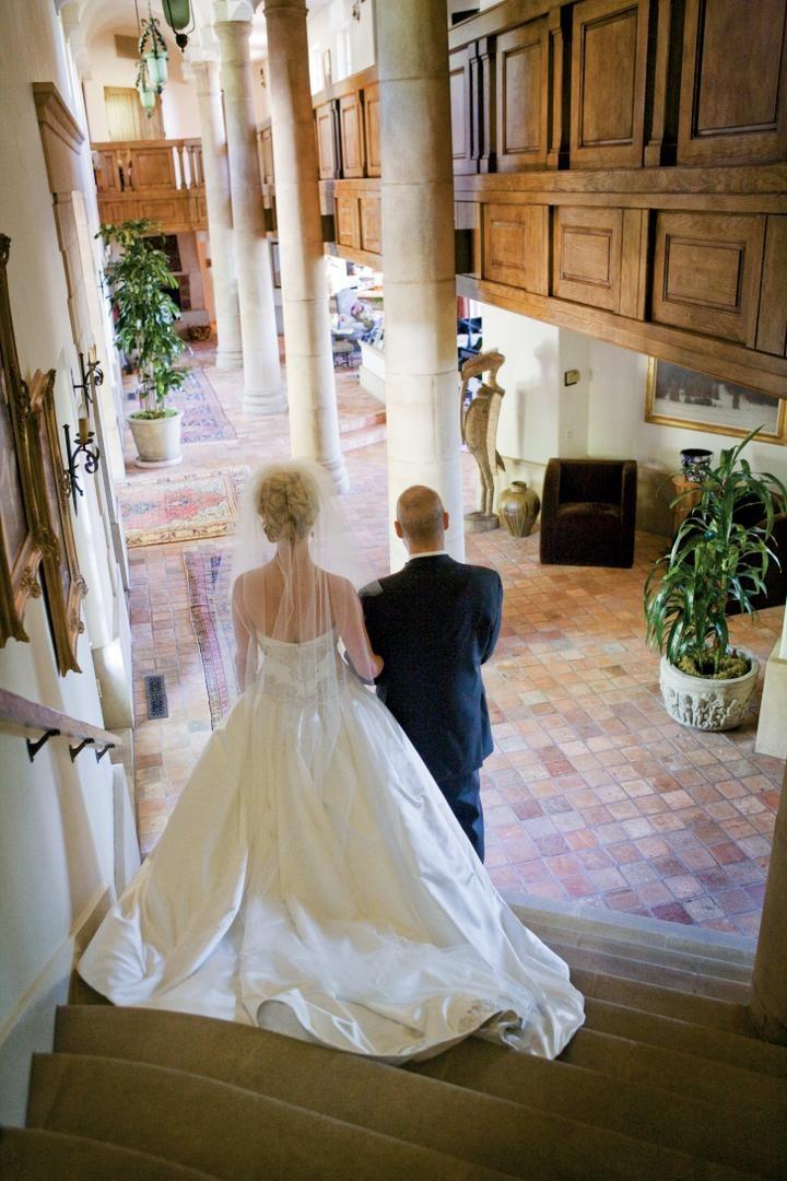 Isabelle Bridges walks down steps with her dad