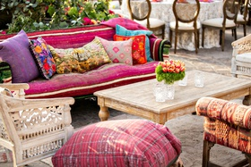outdoor wedding reception lounge boho chic wood furniture pink purple floor pillow furnishings decor