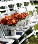 Bridesmaid bouquets of red, orange, and yellow flowers