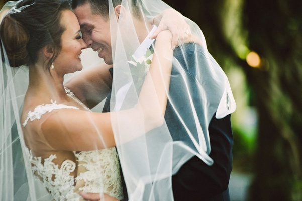 Wedding portrait veil bride and groom smiling illusion wedding dress