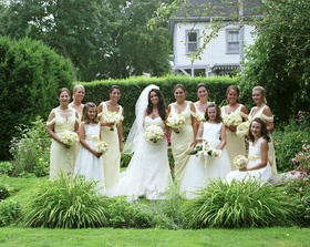 Bride with bridesmaids and three flower girls