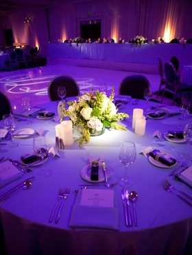 Bright purple lighting on wedding reception table