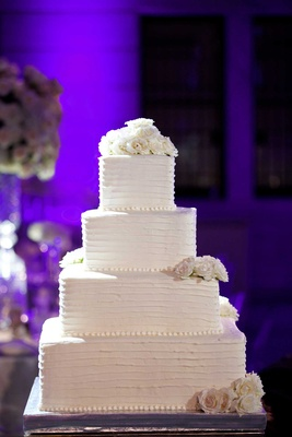 White classic wedding cake with four square tiers for Chad Carroll wedding