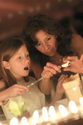 Guests make s'mores at a wedding reception