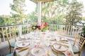 textured white linen flower print napkins pink hot pink flower centerpiece gold flatware gold chairs