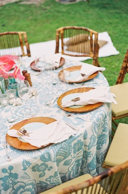 Hawaiian floral linens and wood charger plates
