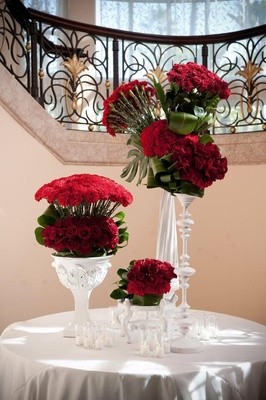Red roses and flowers in white vessels