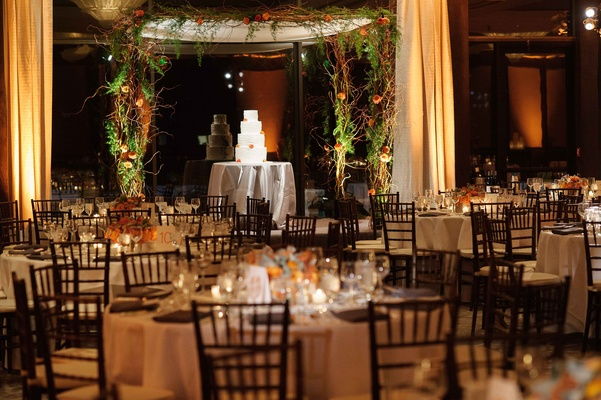 Wedding reception at Brentwood Country Club greenery curly willow branches over wedding cake round