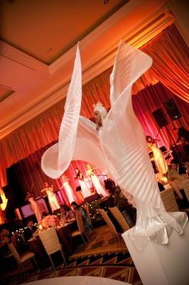 Woman in white fan costume on pedestal