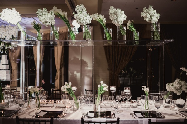 Modern black and white wedding with southern traditions in dallas lucite table on top of wedding head table to display white flowers mightylinksfo