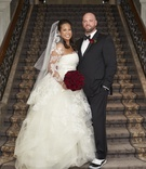 bride in vera wang lace ball gown wedding dress and veil, groom in tuxedo and sneakers