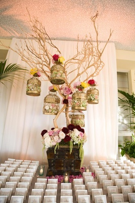 Escort card table display gold bird cages on tree branch