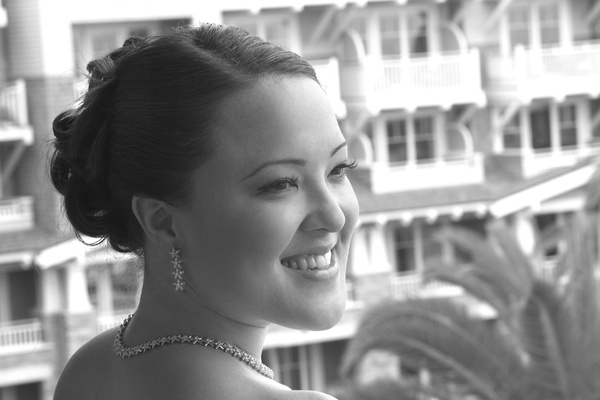 bride wearing matching diamond earrings and necklace