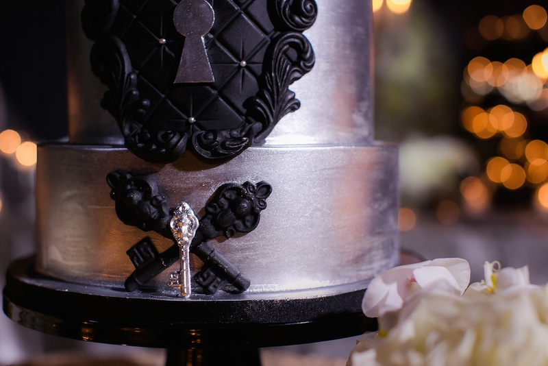 Wedding cake in silver with black tufted details, keyhole, antique key embellishments