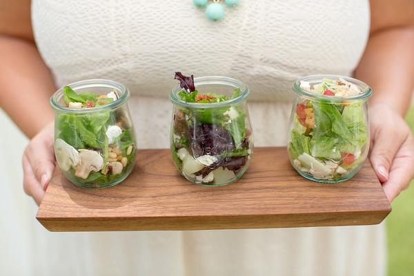 Outdoor wedding shower with pear & pecan salad, chicken Caesar salad, spinach & bacon salad in jars