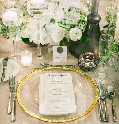 wedding reception white flowers greenery gold charger candle votives place card wax seal candles
