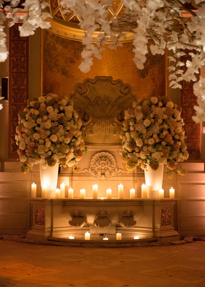 Back Of Wedding Ceremony Ballroom With Candles And Flower Arrangements Orchids Branches