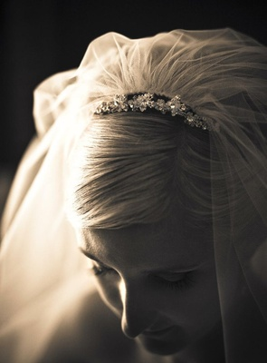 Black and white photo of bridal veil and headpiece