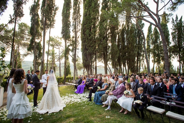 Outdoor wedding ceremony in the Tuscany surrounded by trees
