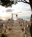 beach ceremony mat aisle white decor colorful flowers ocean punta mita mexico destination wedding