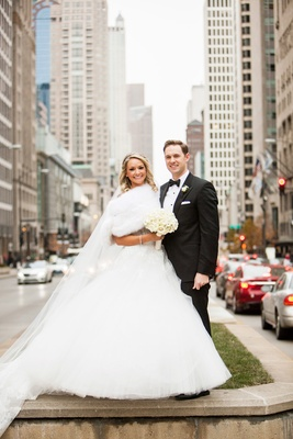 bride in monique lhuillier ball gown and fur shrug, groom in hugo boss, downtown chicago, winter