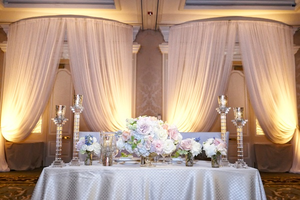 sweetheart table with silver and pastel colors