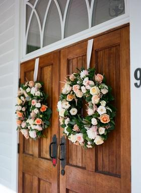Wedding ceremony wood church doors chapel palmetto bluff two wreaths garden rose white pink orange