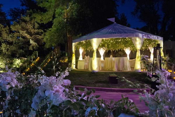 Outdoor White Tent With Drapery And Coffee Station
