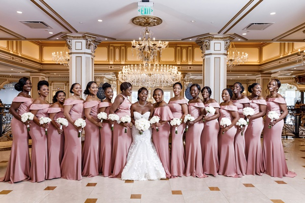 royal wedding the legacy castle bride in sweetheart neckline gown bridesmaids off shoulder pink