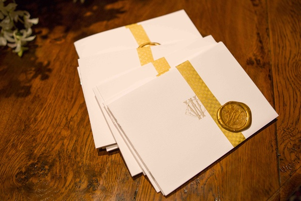 Ceremony program with gold ribbon and wax seal
