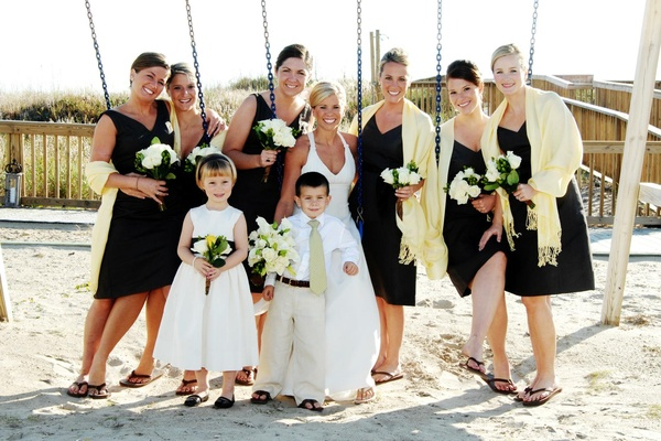 Bride and bridesmaids on beach swings