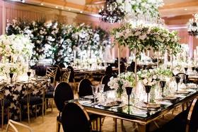 Charlise Castro and George Springer wedding reception black gold wedding decor greenery white flower