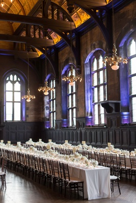 high line hotel historic venue hall long reception tables low centerpiece chandeliers tall ceilings