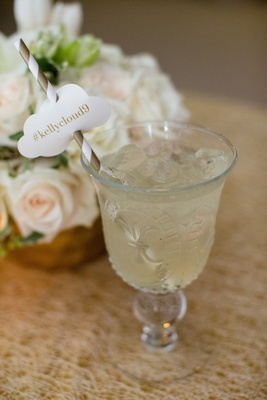 Antique crystal glass with cocktail and custom straw