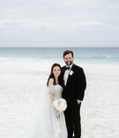bride in off shoulder dress with groom in tuxedo on beach in the bahamas harbour island white sand