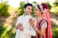 groom looking over should bride indian wedding traditional garb sari cultural california