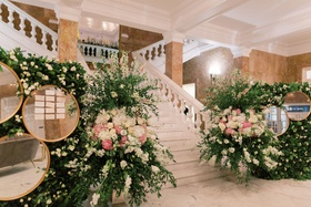 wedding reception puerto rico ballroom marble staircase gold mirror greenery white pink flowers