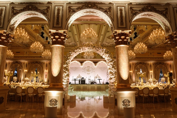 wedding reception arch live band stage dance floor gold details white flowers