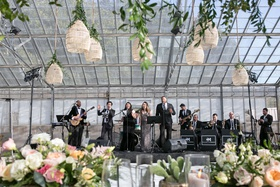 wedding reception live band woven lantern greenery rustic chic decor cactus candles flowers