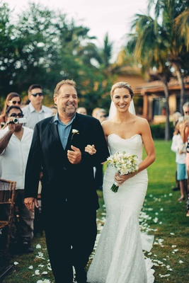 brides father walks her down beach aisle black suit blue shirt punta mita mexico destination wedding