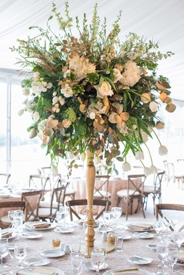 Gold wedding centerpiece with green leaves, rose, tulip, laser cut table number