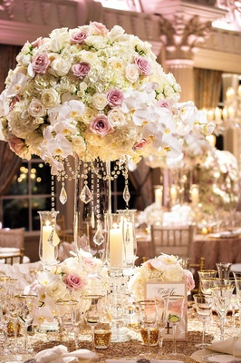 Megan Wollover and Tracy Morgan wedding reception centerpiece and sequin linens