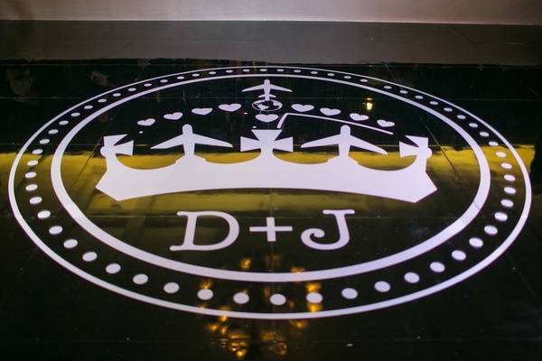 Crown and airplane monogram on reception dance floor